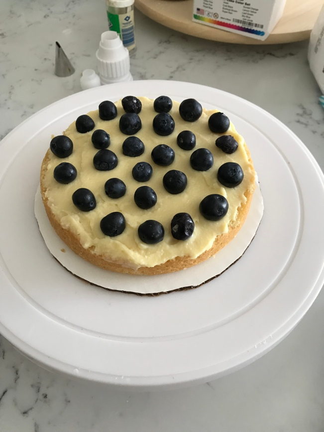 Cake layer with pastry cream and blueberries